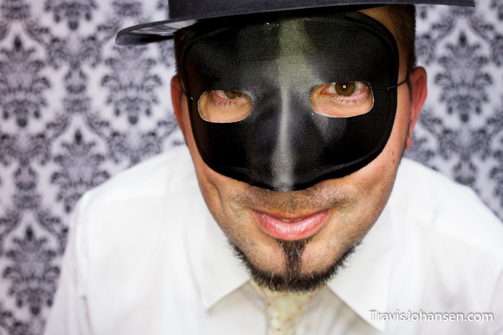 Groom with mask in photo booth - Schaars Bluff MN